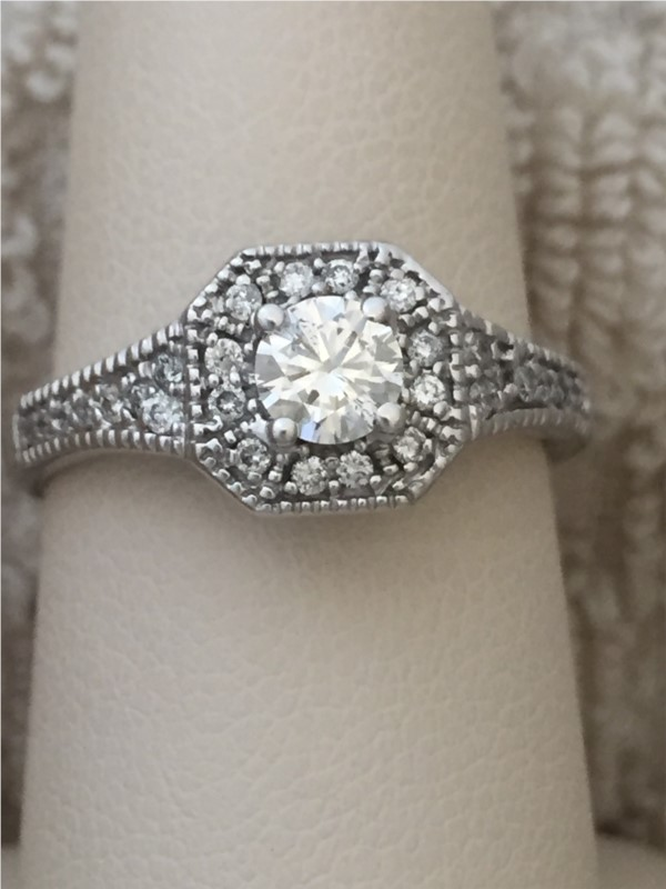 Engagement Ring - Lady's White 14 Karat Engagement Ring With One 0.32Ct Round Diamond And 0.24Tw Round Diamonds