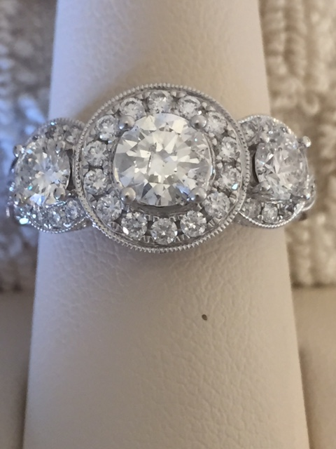 Engagement Ring - Lady's White 14 Karat Engagement Ring With One 0.75 Ct Round G Si2 Diamond And 1.25Tw Round H/I Si2 Diamonds.  The total diamond weight is 2.0 carats.