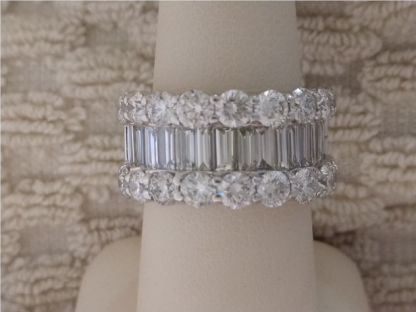 Wedding Band - Lady's White 14 Karat Wedding Band With 2.24Tw Baguette H/I Si1 Diamonds And 18=3.60Tw Round G/H Si1 Diamonds. Total diamond weight is 5.84 carats.
