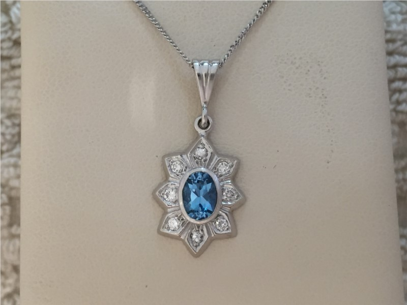 Pendants - Lady's White 14 Karat Pendants With One 0.49Ct Oval Blue Topaz And 0.14Tw Round Diamonds