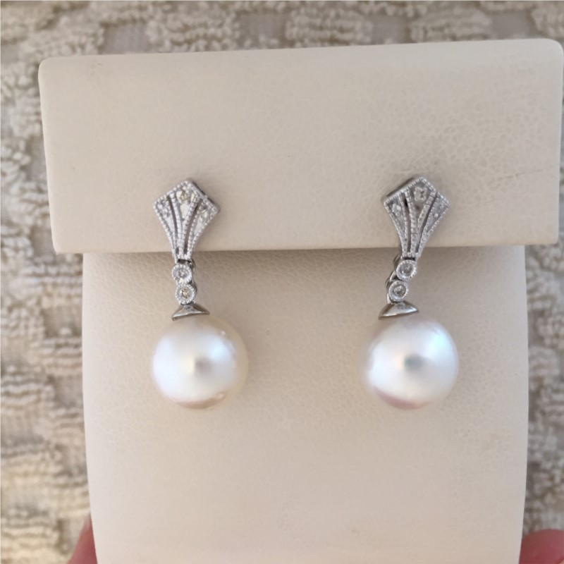 Earrings - Lady's White 14 Karat Pearl Earrings With 2= Cultured Pearls And 0.06Tw Round Diamonds