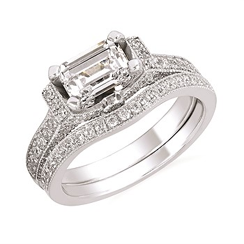 East-West Style Engagement Mounting - Set with 0.50 carats total of diamond accents, this east-west style ring mounting is made for a 1 carat center and shown with a 1 carat emerald cut diamond. Made of 14 karat white gold, this ring comes in size 6.5