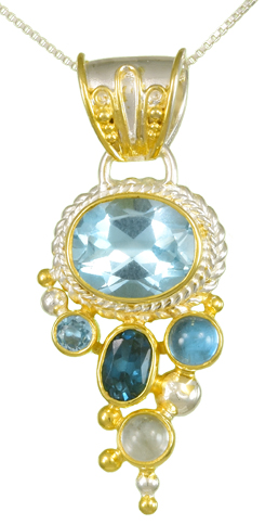 Gemstone Cascade Pendant - Sterling silver and 22kt vermeil cascade pendant with sky, london, and baby blue topaz on 18