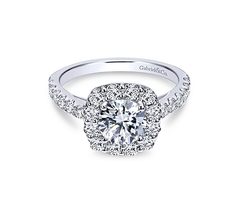 Skylar - 14kt white gold Gabriel & Co diamond semi-mount engagement ring with .91ctw. This ring features a diamond infused halo that adds an extra hint of sparkle to the center stone. Paired with 14k white gold diamonds trickling down the each of the sides, its made for a woman not afraid to be bold. Center stone sold separately.