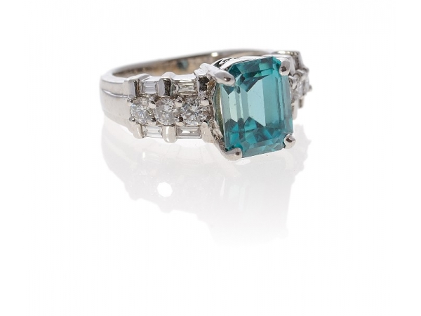 14kwg Blue Zircon and Diamond Ring - 14kwg Blue Zircon and Diamond RingBlue Zircon: 4.25ct Emerald CutDiamonds: (6) = 0.42ct tw Round Brilliant Cuts                  (4) = 0.25ct tw Baguette Cuts Weight: 6.8 grams