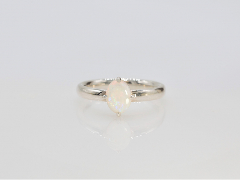 Opal Ring Sterling Silver - This opal ring was made on site with an oval white opal and prong set into sterling silver by designer/jeweler, Rob Shinsky. Dainty and sweet, this opal ring is the perfect treat!