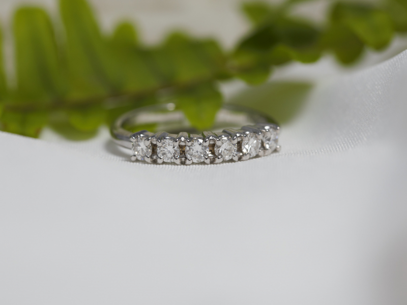 White Gold Classic Diamond Wedding Band - A women's classic diamond wedding band set in 14k white gold. The diamond wedding ring features 6 diamonds totaling .25 carats. If you need this classing white gold wedding band in a ring size that's not listed, give our Palm Harbor, Florida jewelry studio a call: 727-785-9624.