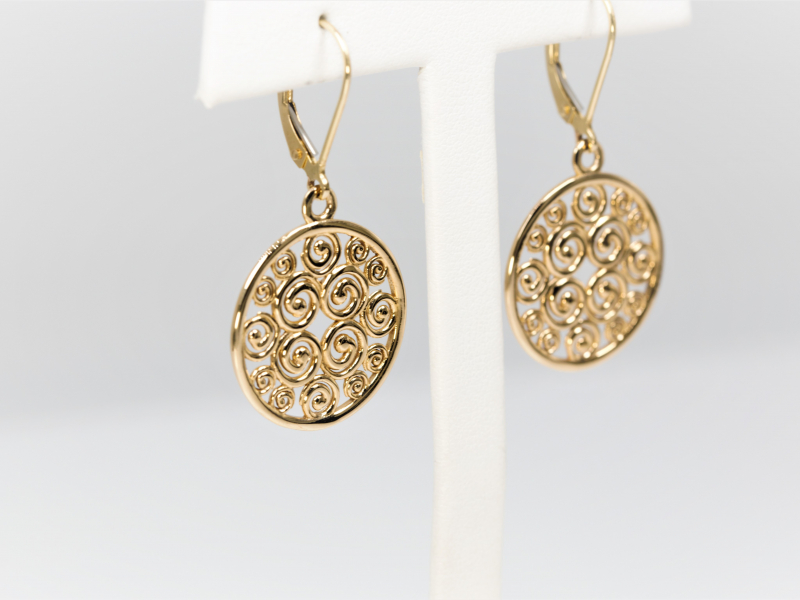 Hoop, stud, dangle, gemstone, silver, gold, diamond earrings are a few of the different types of earrings Les Olso - image #5
