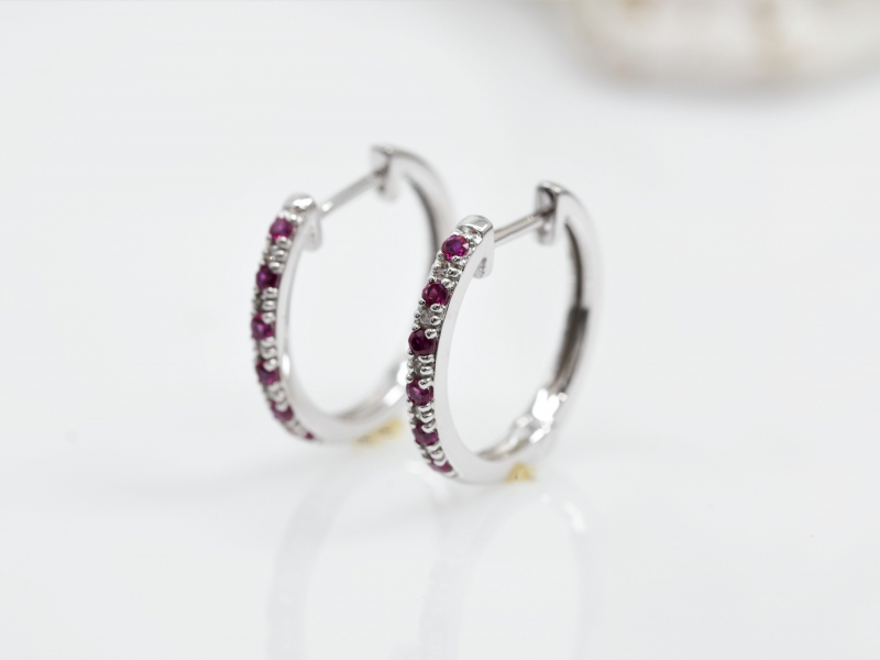 Hoop, stud, dangle, gemstone, silver, gold, diamond earrings are a few of the different types of earrings Les Olso - image #3