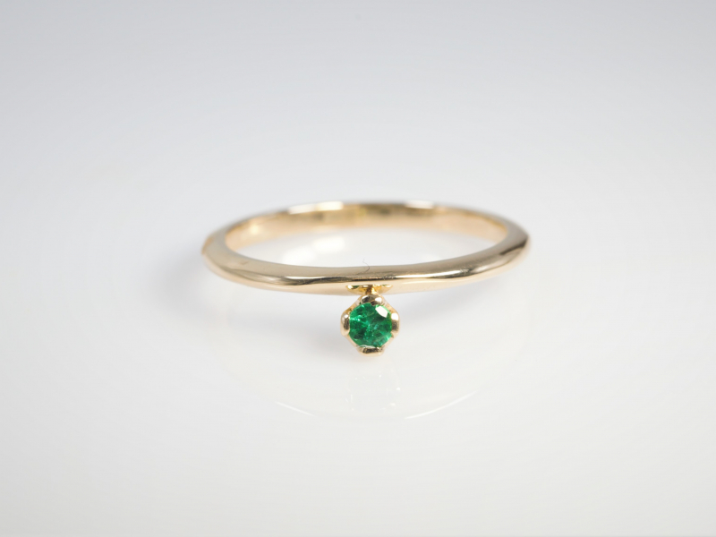 Emerald Stackable Ring in 14k Yellow Gold - Check out this dainty emerald stackable. Dont be fooled by this rings daintyness or price, this is a custom design made with the highest quality craftsmanship and solid 14k yellow gold in our Palm Harbor studio, this is a durable ring thats built to last a lifetime.