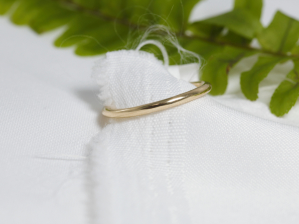 Dainty Gold Wedding Band - This dainty gold wedding band is made of solid 14K yellow gold. The simple wedding band is perfect with almost any engagement ring. Get your custom wedding ring from our Palm Harbor, Florida jewelry studio.