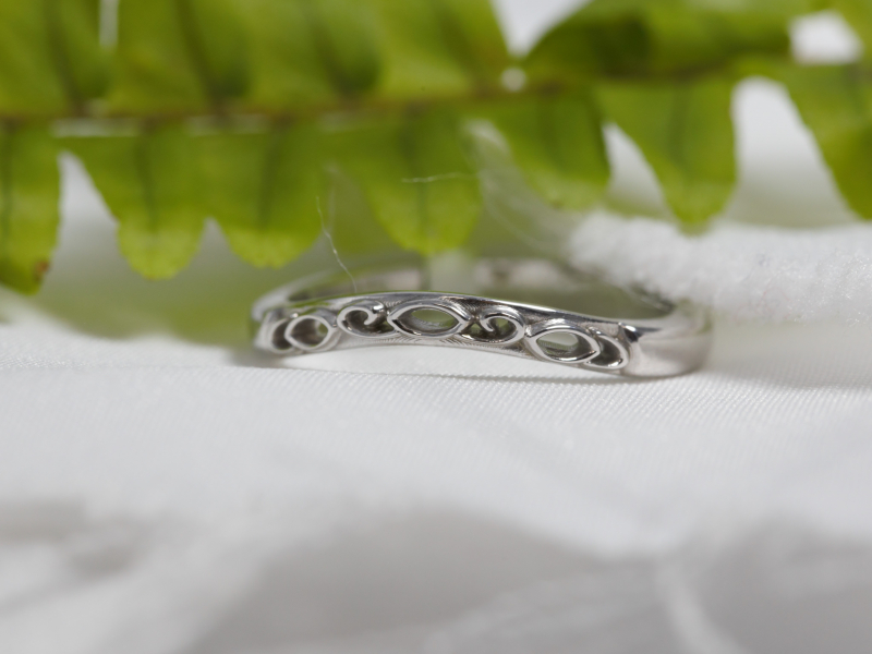 Curved Wedding Band 14k White Gold - This 14kt white gold curved wedding band fits perfectly well up against the matching engagement ring. The vintage-inspired design gives this wedding band extra character. Custom made in our Palm Harbor, Florida studio.