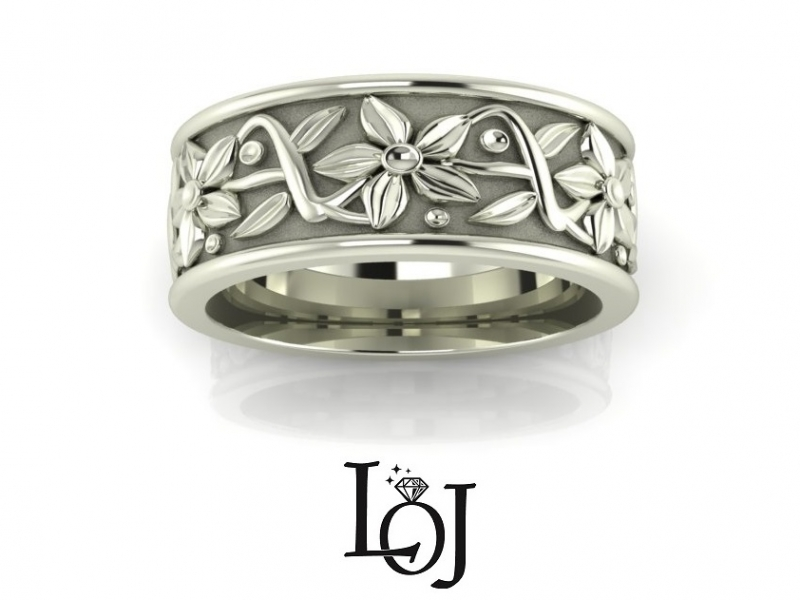Les Olson Jewelers is a custom jeweler.  We create custom made jewelry including engagement rings, wedding bands, rings, brac
