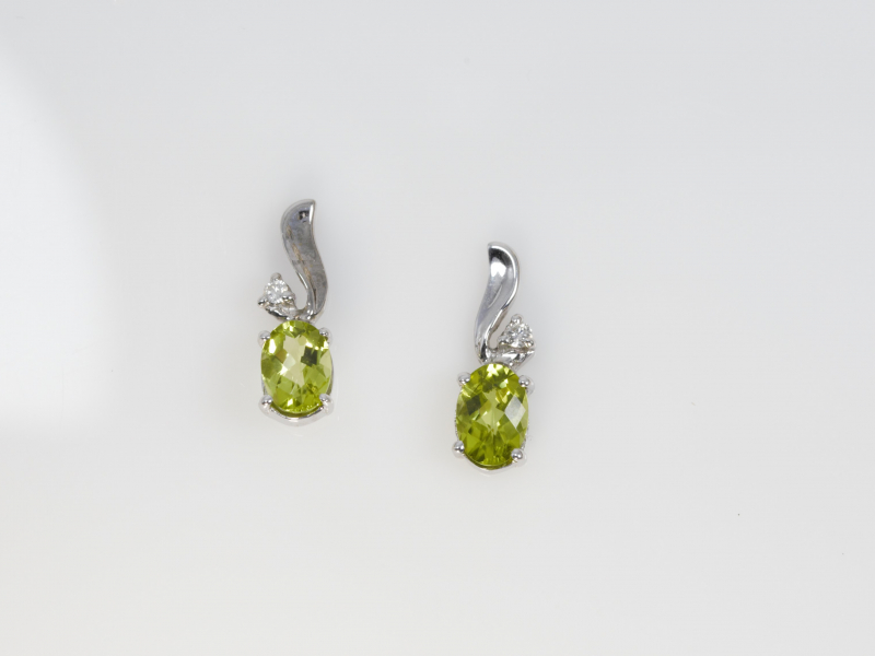 Peridot Earrings 14k White Gold  - These peridot earrings have 1.70 total gemstone weight of peridots and .05 total carat weight of accent diamonds. They are set into 14k solid white gold and are checkerboard cut.