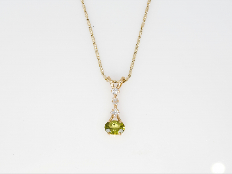 Custom Peridot and 3 Diamond Ladies Pendant (August Birthstone) - This elegant custom pendant made in our Palm Harbor studio by designer and jeweler, Rob Shinsky. This pendant is an 18 karat yellow gold and oval Arizona Peridot with 3 cascading diamonds; a round, a baguette and a princess cut. This pendant is perfect for August birthdays or anyone who loves lush green gemstone jewelry! Chain sold separate.