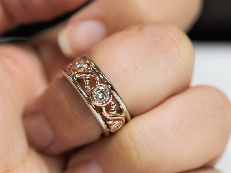 custom jewelry, palm harbor rings, rose gold diamond ring Two-Toned Gold Diamond Ring with Rose Gold Embellishments