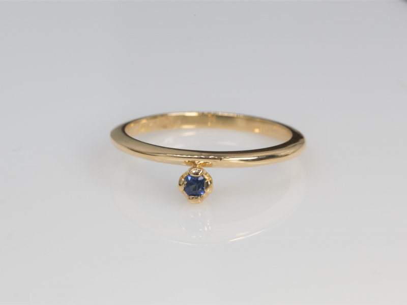 Sapphire Stackable Ring 14k Yellow Gold - Featuring a .07 carat round sapphire and solid 14kt yellow gold, this cusotm stackable is a quality custom piece from our Palm Harbor studio that is budget freindly!