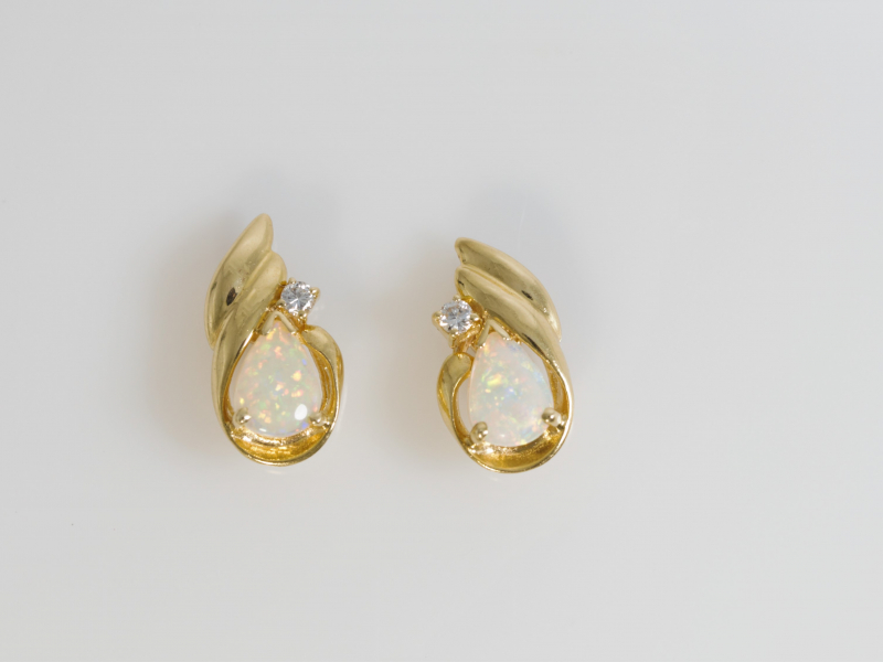 Opal Earrings 14k Yellow Gold - Pear shaped opal earrings with an accent diamond. Set into solid 14k yellow gold.