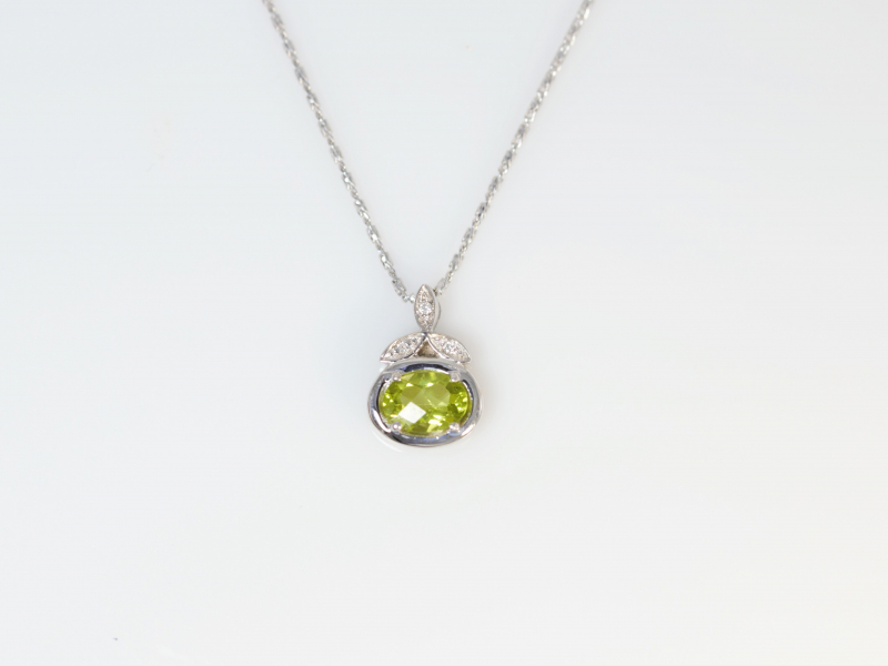 Peridot Pendant 14k White Gold - A pretty oval peridot with a leaf crown of diamonds set into 14k white gold. This is a unique peridot pendant and would make a perfect birthday gift for a August birthday.
