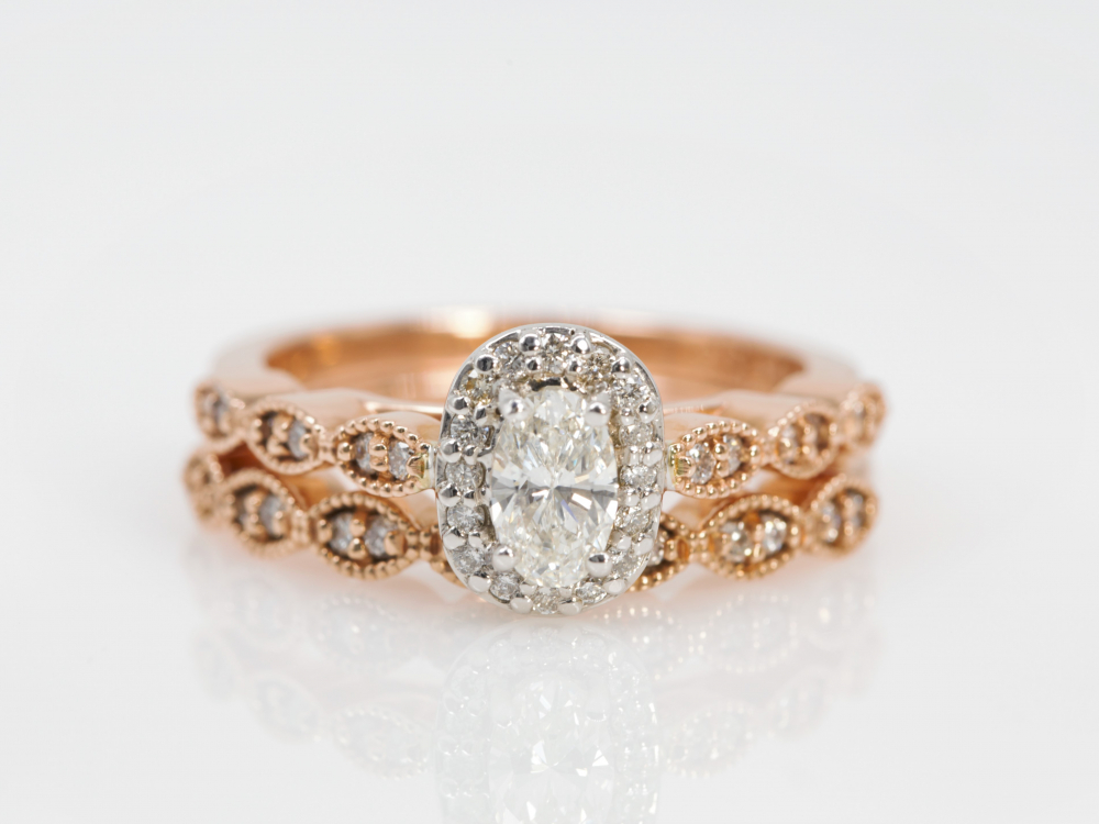 Oval Engagement Ring With Halo and Vintage Band in Rose Gold